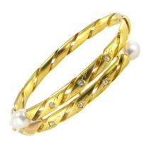 Bracelet jonc ciselé diamants et perles fines