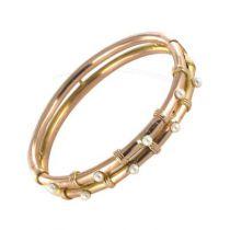 Bracelet jonc ancien en or rose et perles