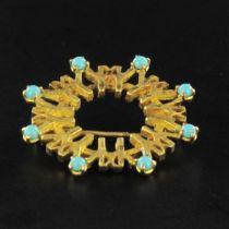 Broche en or et turquoises