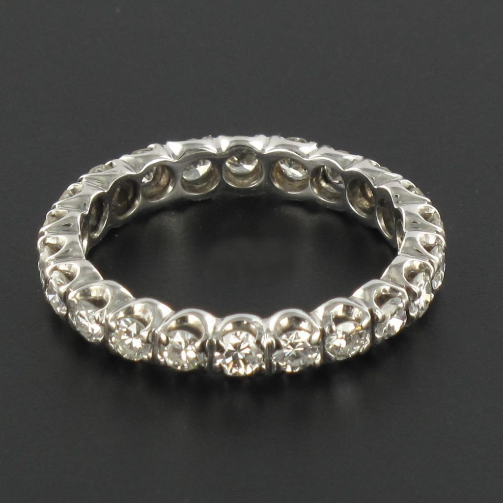 Alliance diamants or blancs sertis griffes