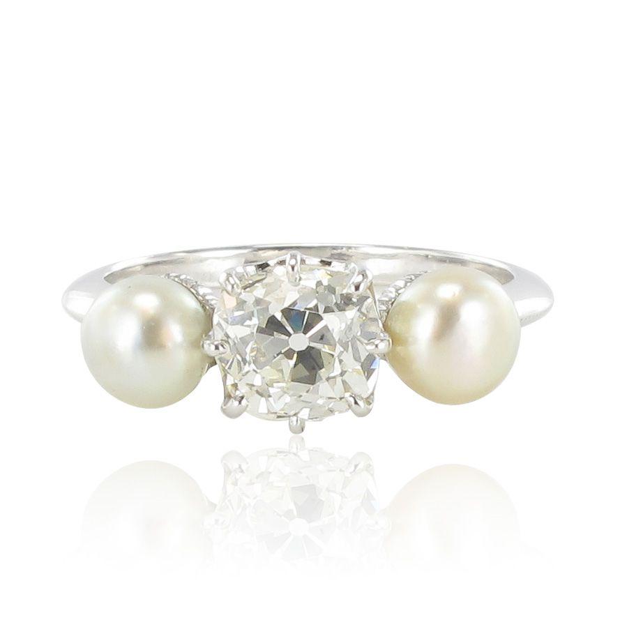 Bague diamant coussin et perles fines boutons