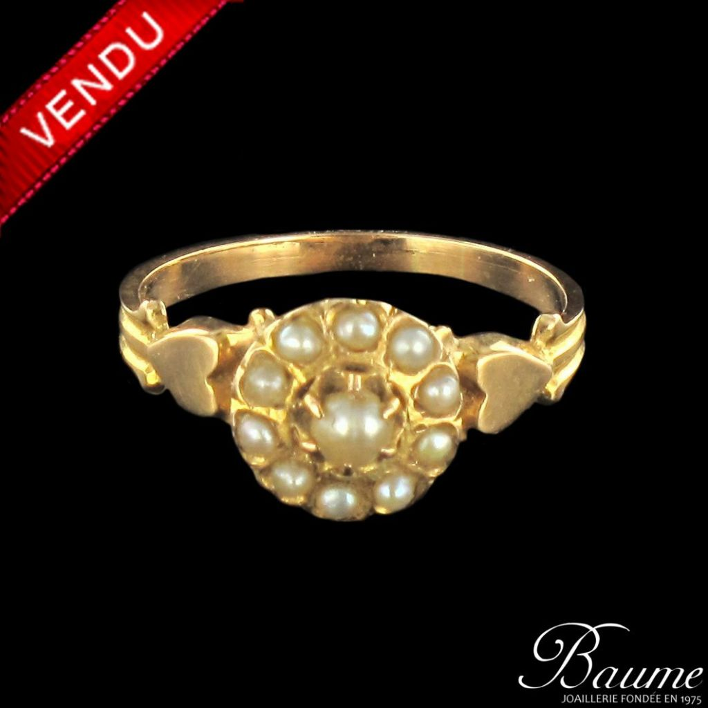 Bague en or rose et perles fines