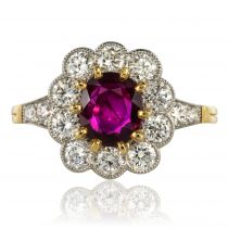 Bague entourage rubis et diamants