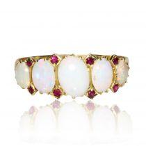Bague jarretière opales et rubis
