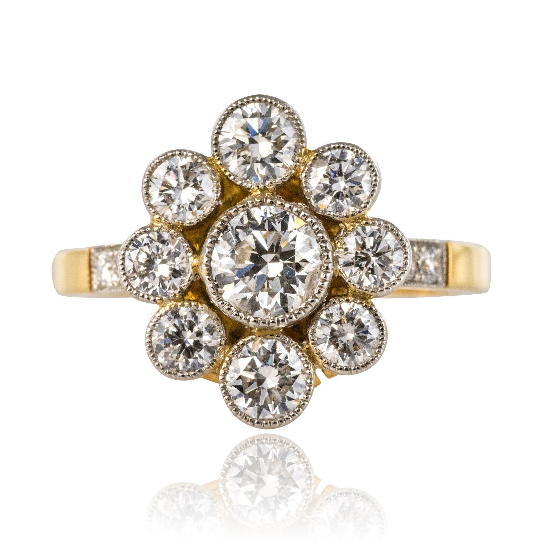 Bague marguerite diamants sertis clos perlés