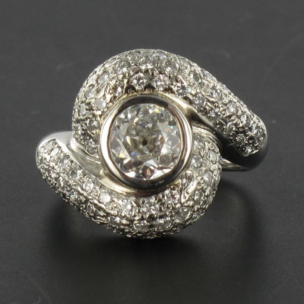 Bague tourbillon diamants or blanc