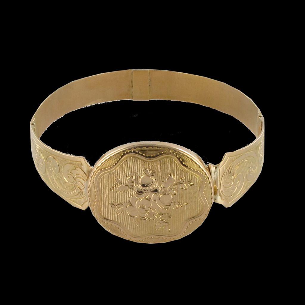 Bracelet ancien jonc ouvrant motif ovale ciselé