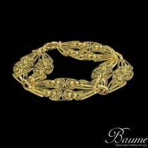 Bracelet en or larges motifs à filigranes