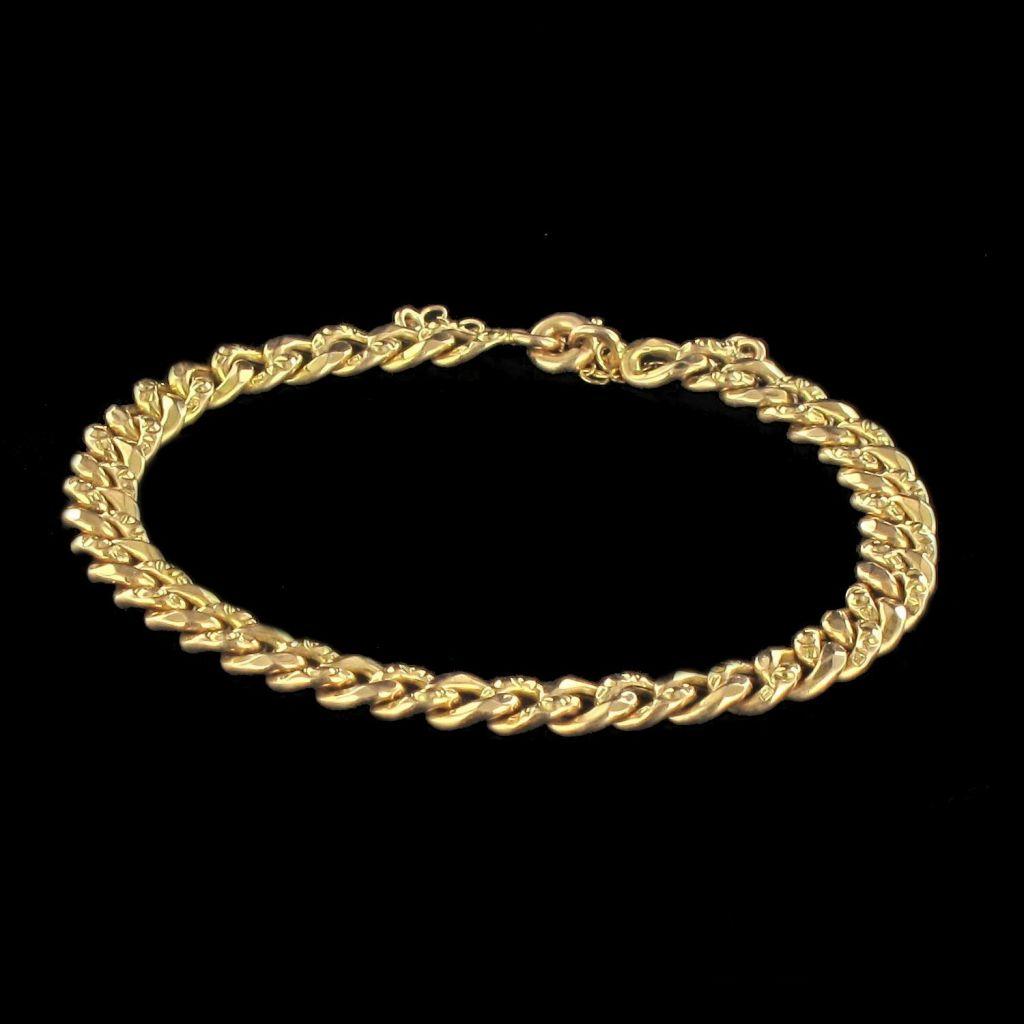 Bracelet gourmette en or ciselé