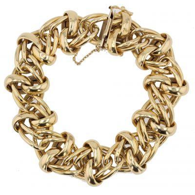 Bracelet gourmette en or jaune aux motifs entrelacés