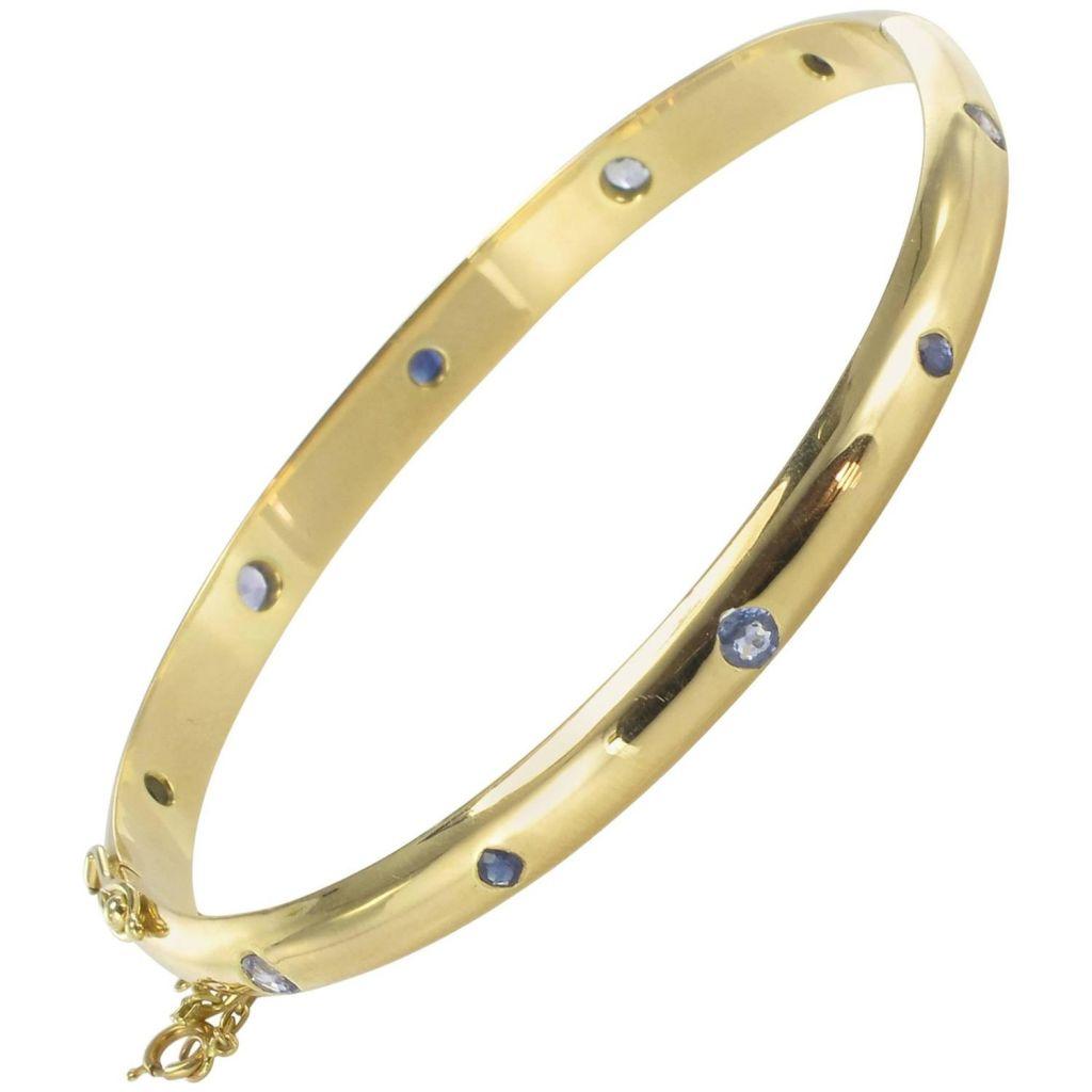 Bracelet jonc or jaune et saphirs