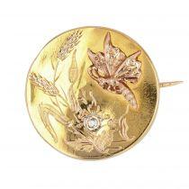 Broche ancienne de col papillon et son diamant