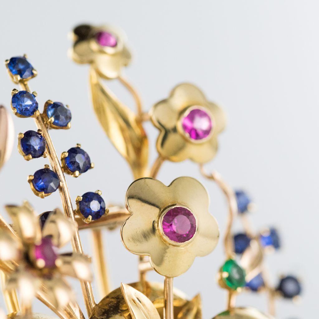 Broche rétro bouquet or et pierres précieuses