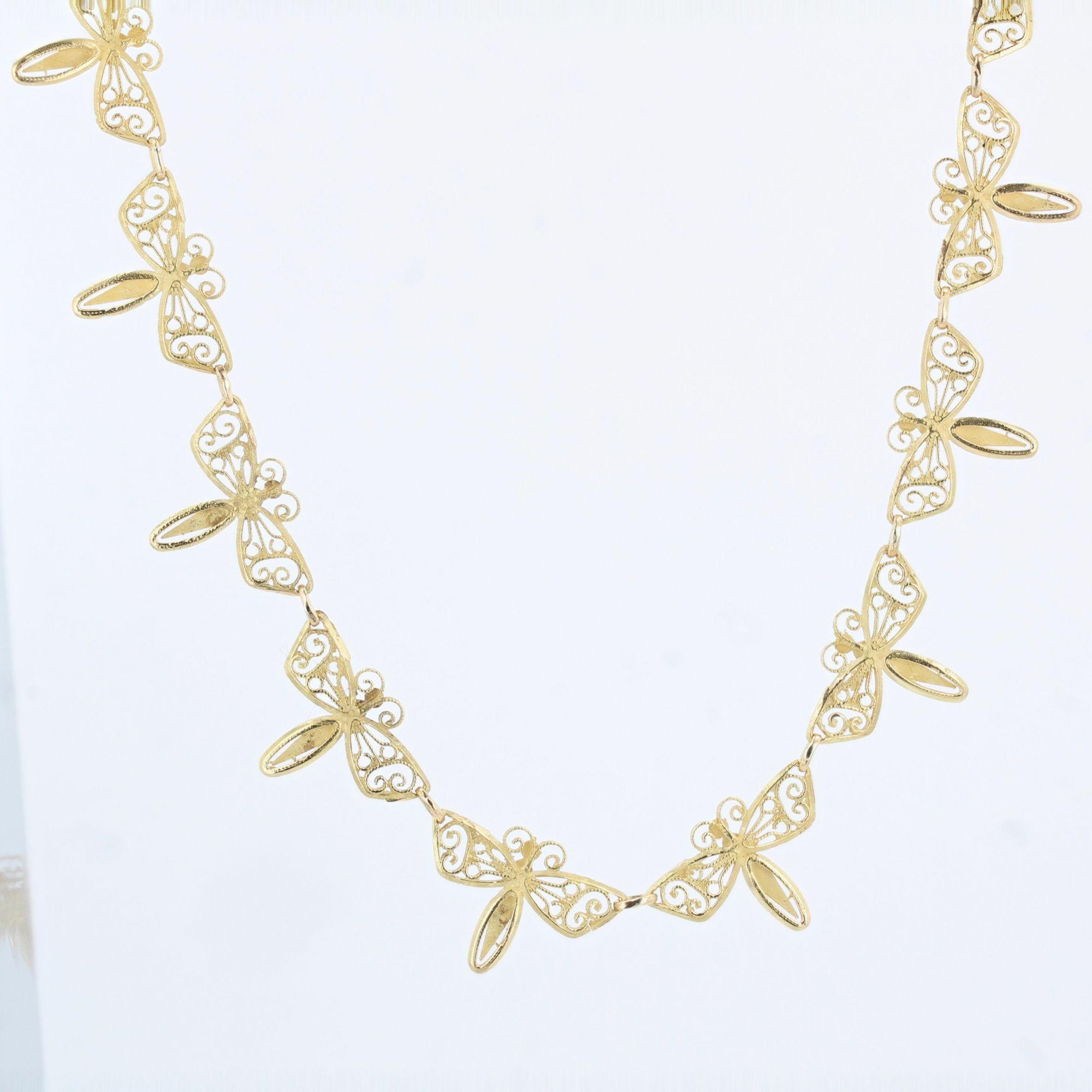 Collier ancien en or aux papillons