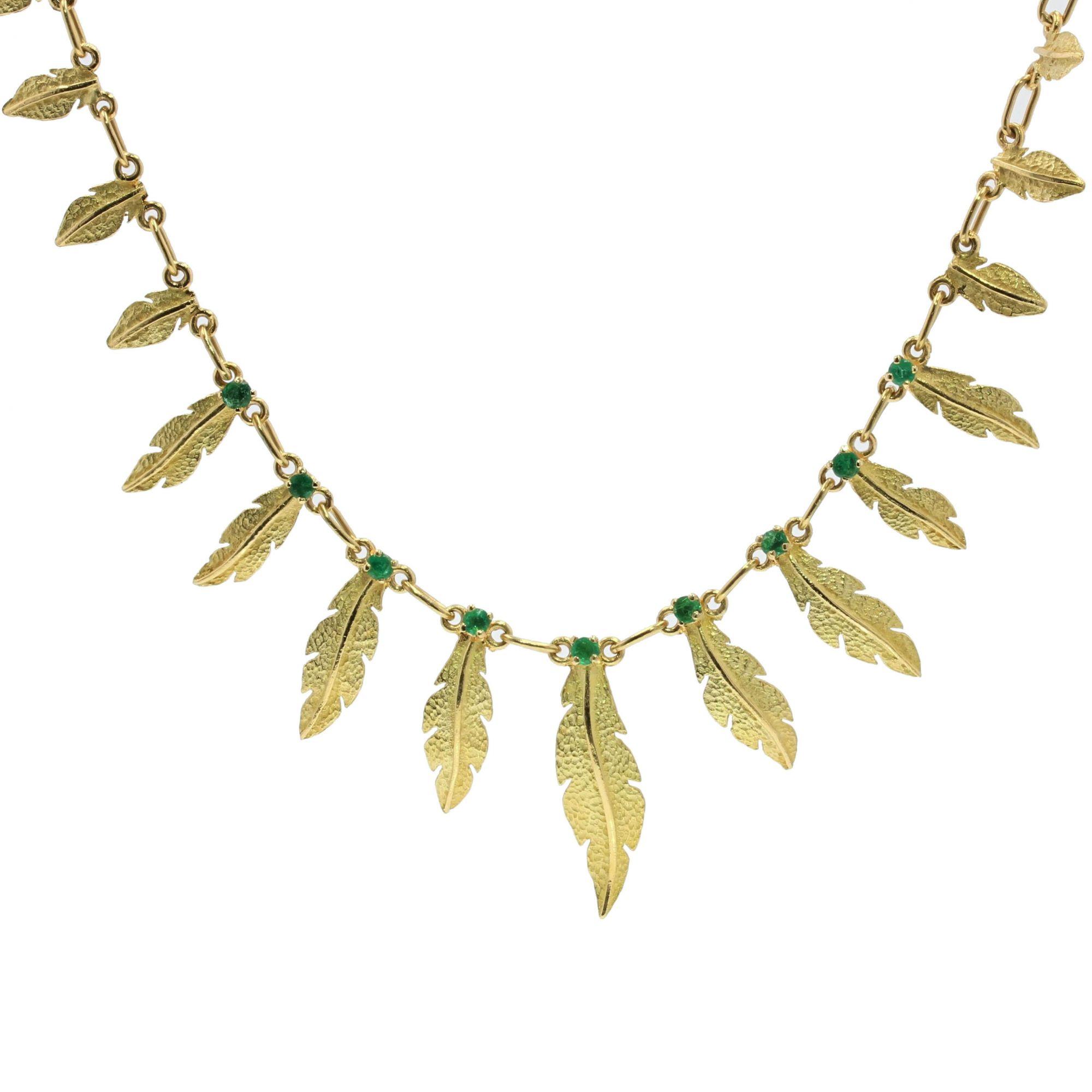 Collier en or et émeraudes plumes