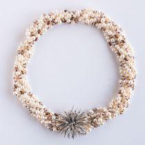 Collier en perles fermoir broche diamants