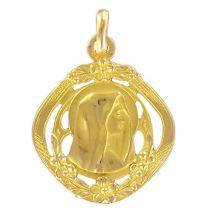 Médaille or vierge et décor végétal