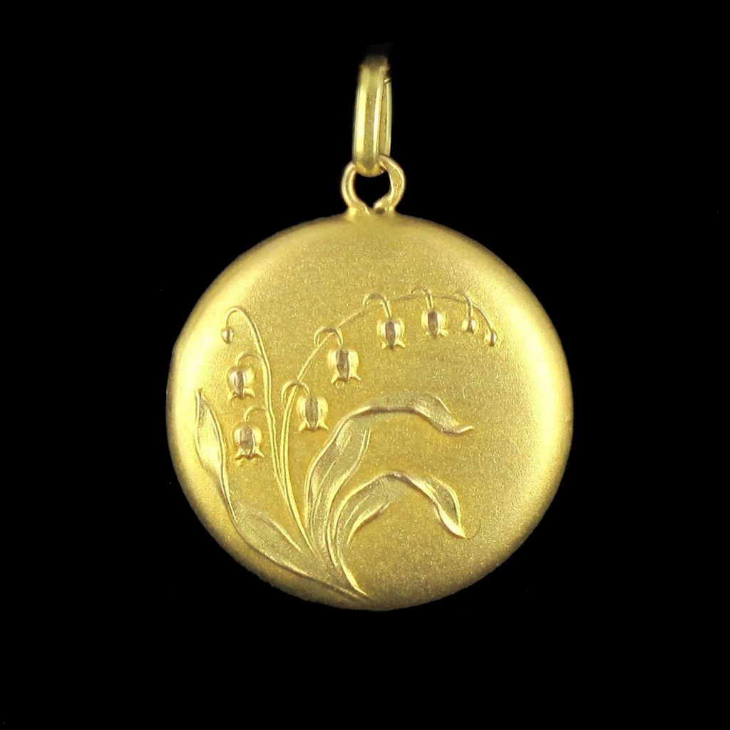 Médaillon en or brin de muguet