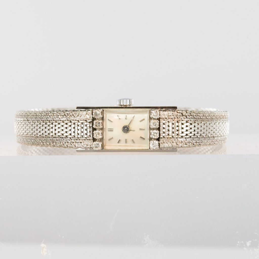 Montre ancienne or blanc et diamants