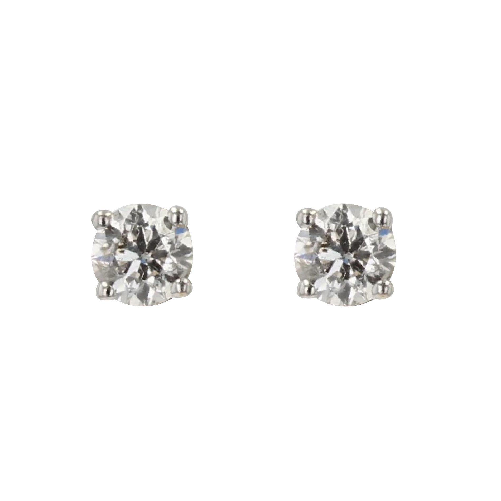 Puces d\'oreilles en diamants et or blanc